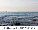 sunset on the water with the... | Shutterstock . vector #1067545505