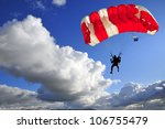 red parachute landing on stormy ... | Shutterstock . vector #106755479