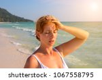 woman having sun stroke on... | Shutterstock . vector #1067558795