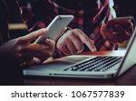 hand of woman using smartphone... | Shutterstock . vector #1067577839