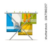 clothes rack with laundry....   Shutterstock .eps vector #1067580257