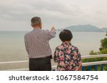 the old man looking at the sea...   Shutterstock . vector #1067584754