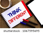 Small photo of Handwriting text Think Different. Concept meaning Rethink Change on vision Acquire New Ideas Innovate written on Notebook Book on the jute background Tablet Coffee Cup and Pens next to it.
