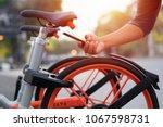 scan the qr code to a smart... | Shutterstock . vector #1067598731