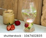 Small photo of Strawberry cucumber and mint detox water on rustic wood table with creamy organic honey natural sweetener and refreshing healthy summer drink photography concept