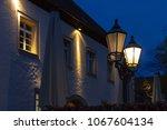 streetlamp on blue hour sunset... | Shutterstock . vector #1067604134