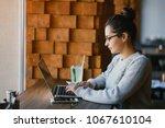 brunetter woman working on her... | Shutterstock . vector #1067610104