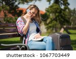young woman is going on city...   Shutterstock . vector #1067703449