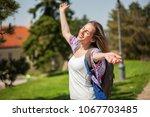 happy young woman is enjoying...   Shutterstock . vector #1067703485