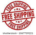 free shipping round red grunge... | Shutterstock .eps vector #1067739221