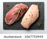raw duck breasts  magret on a...   Shutterstock . vector #1067753945