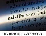 Small photo of ad-lib word in a dictionary. ad-lib concept.