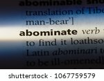 Small photo of abominate word in a dictionary. abominate concept.