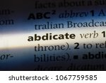 Small photo of abdicate word in a dictionary. abdicate concept.