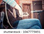 girl playing guitar in... | Shutterstock . vector #1067775851