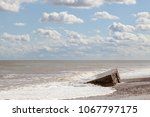 coastal erosion and flooding.... | Shutterstock . vector #1067797175
