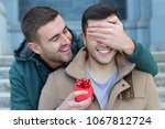 gay man popping the question  | Shutterstock . vector #1067812724