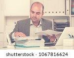 portrait of male worker in the... | Shutterstock . vector #1067816624