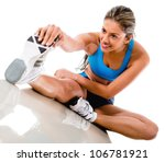 Gym woman stretching leg - isolated over a white background - stock photo