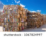stack of paper waste before... | Shutterstock . vector #1067824997