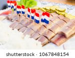 Stock photo netherlands herring on the plate 1067848154