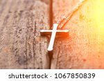 silver cross on a wood... | Shutterstock . vector #1067850839