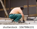 bricklayers at work in a... | Shutterstock . vector #1067886131