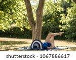 woman in a sun hat relaxing on... | Shutterstock . vector #1067886617