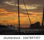 sunset on hudson river  yacht... | Shutterstock . vector #1067897357