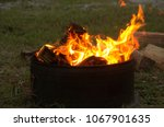 a campfire burns and creates a... | Shutterstock . vector #1067901635