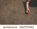 a girl hand lying on the floor. ... | Shutterstock . vector #1067915081