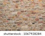an old sandstone castel wall | Shutterstock . vector #1067928284