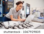 female engineer using cad... | Shutterstock . vector #1067929835