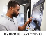 male engineer operating cnc... | Shutterstock . vector #1067940764