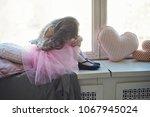 girl in pink petticoat sinng... | Shutterstock . vector #1067945024