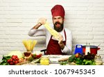 chef makes dough. cook with... | Shutterstock . vector #1067945345