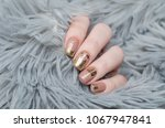 beige nude manicure with gold... | Shutterstock . vector #1067947841