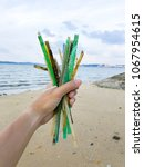 plastic straws found on a beach ... | Shutterstock . vector #1067954615