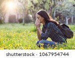 young pretty woman blowing nose ... | Shutterstock . vector #1067954744
