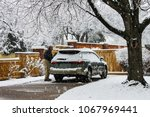 middle aged man with snow... | Shutterstock . vector #1067969441