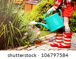 Little Girl In A Garden With...