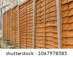 wooden fence held up by... | Shutterstock . vector #1067978585