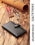 black leather wallet.genuine... | Shutterstock . vector #1067979095