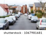 blurred image of cars parked on ... | Shutterstock . vector #1067981681