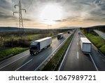 caravan or convoy of trucks in... | Shutterstock . vector #1067989721