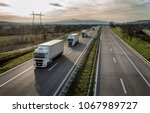 caravan or convoy of trucks in... | Shutterstock . vector #1067989727