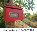 Red Mailbox Attached On A...