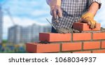 bricklayer worker installing... | Shutterstock . vector #1068034937