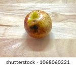 apple is about to expire on... | Shutterstock . vector #1068060221