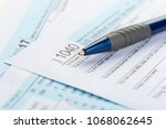 tax forms  close up | Shutterstock . vector #1068062645